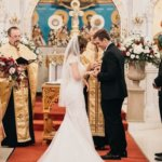 Bride and groom praying during wedding ceremony