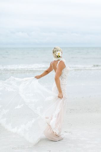 bride twirling her wedding gown on Clearwater Beach