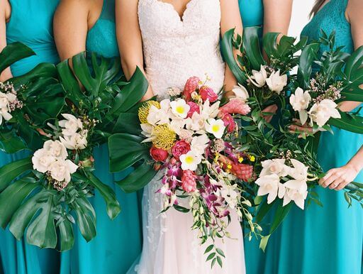 bride and bridal party holding tropical Hawaiian wedding bouquets