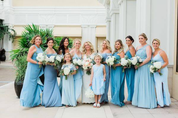 Clearwater Beach destination wedding party wearing beautiful dresses in shades of blue