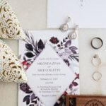 flat lay photo of boho chic bridal accessories including her shoes jewelry and invitation