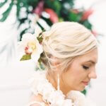 close up photo Clearwater Beach bride wearing a Hawaiian wedding lei and orchids in her hair