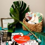 tropical inspired props for wedding photo booth