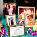 ftable filled with family photos and Hawaiian flowers