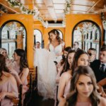 bride and wedding party riding in a trolley