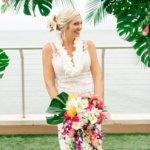 laughing bride holding a tropical Hawaiian wedding bouquet