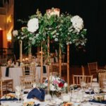 tall gold risers with flowers and candles at Saint Petersburg Coliseum wedding reception