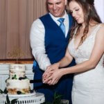 bride and groom cutting their naked wedding cake during their wedding reception at the Saint Petersburg Woman's Club
