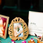Hawaiian themed picture frame and decor on guest book table