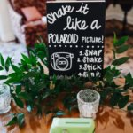 Signage for a Polaroid Camera wedding guest book at a Saint Petersburg Woman's Club wedding