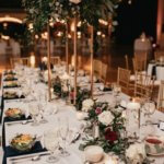 long banquet tables with gold burgundy and pink decor