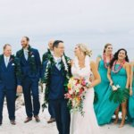 bride and groom with wedding party on Clearwater Beach