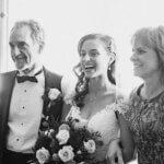 Parents escorting bride down the aisle