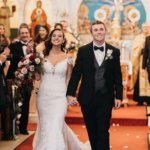 bride and groom walking uf the aisle after their Saint Petersburg Greek Orthodox wedding ceremony
