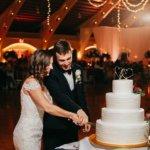 Bride and groom cutting their wedding cake at their Saint Petersburg Coliseum wedding reception