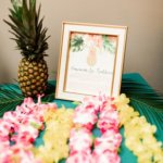 table at wedding reception with traditional Hawaiian leis for wedding guests