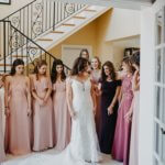 Wedding party seeing bride for the first time