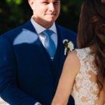groom holding back tears at his Saint Petersburg Florida wedding ceremony