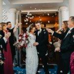Wedding guests tossing petals at newlyweds after their Saint Petersburg Greek Orthodox wedding