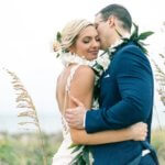 bride and groom portrait in tall grass