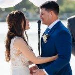 bride and groom exchange wedding vows during their Saint Petersburg Florida waterfront wedding ceremony