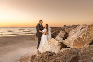 South Asian bride and groom at sunset Sand Key Park