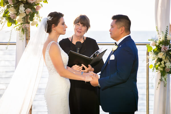 Clearwater Beach couple holding back tears as they exchange wedding vows at the Opal Sand Resort