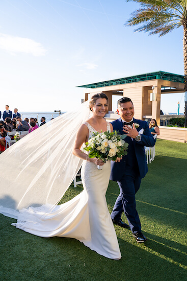Just Married, newlywed couple excited after their Opal Sands wedding ceremony