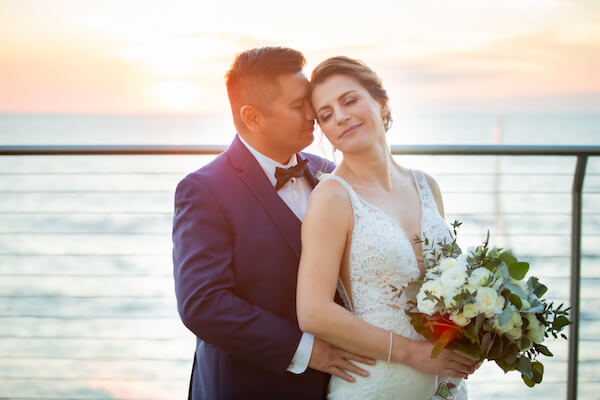 bride and groom as the sunsets outside of the Opal Sands Resort