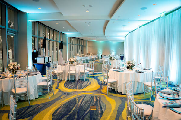 silver and blue decor of an intimate wedding at the Opal Sands Resorts Sea Salons