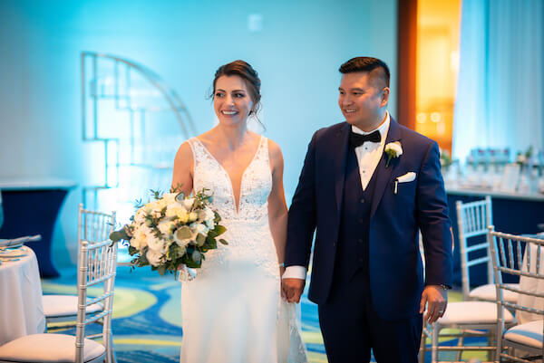 bride and groom getting a sneak peek at their wedding reception at the Opal Sands Resort in Clearwater Beach