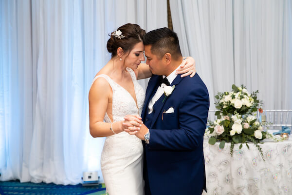 bride and groom's first dance at their Opal Sands Resort wedding reception