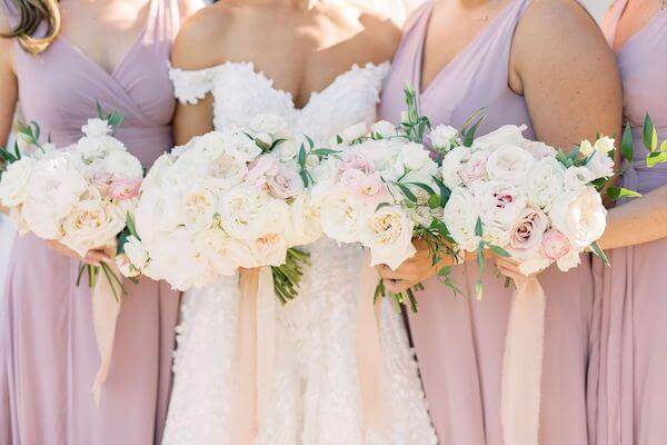 bride and bridal party with lush pink and white bridal bouquets