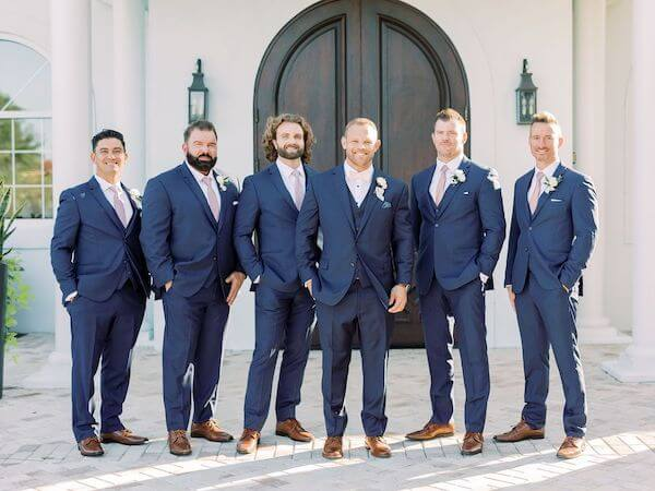 Groom and Groomsmen in navy-blue suits at Harborside Chapel in Safety Harbor