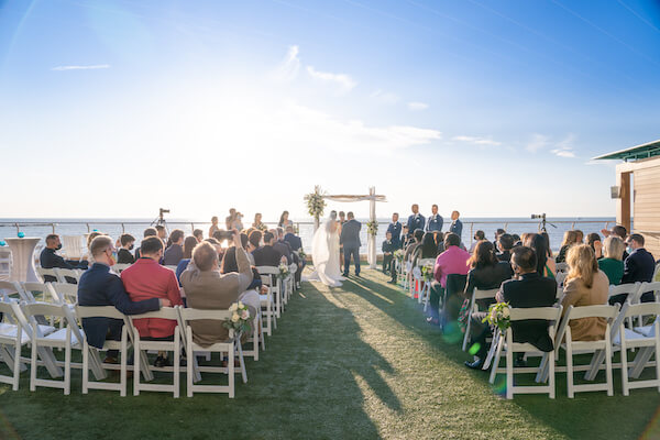 bride and groom exchanging wedding vows during their outdoor wedding ceremony at the Opal Sand Resort