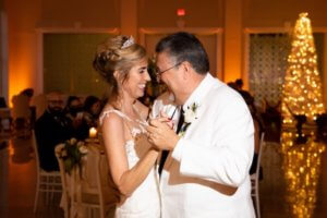 bride and groom's first dance during their Christmas wedding at The Vault in Tampa