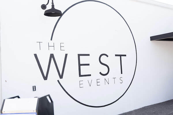 The West Events logo mural alongside the entrance to the Tampa Bay wedding venue