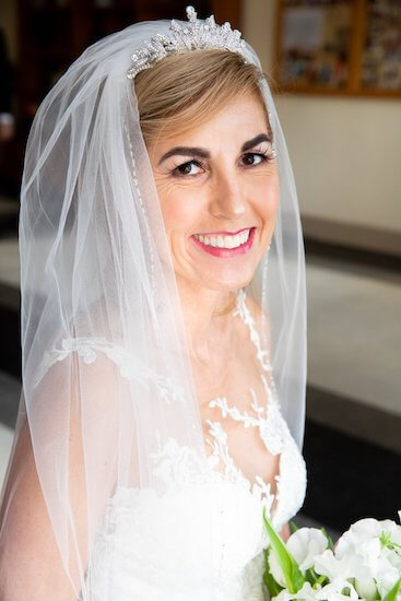 Tampa bride wearing a white lace wedding gown and a rhinestone tiara