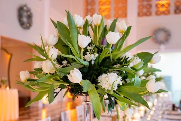 tall centerpiece of white and purple tulips