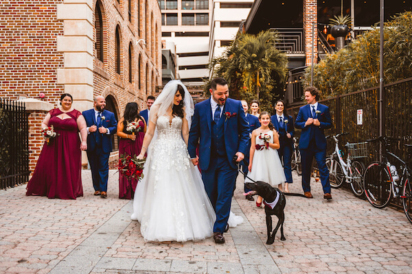 newlyweds and their wedding party had off for photos with their dog after their downtown St Pete rooftop wedding ceremony