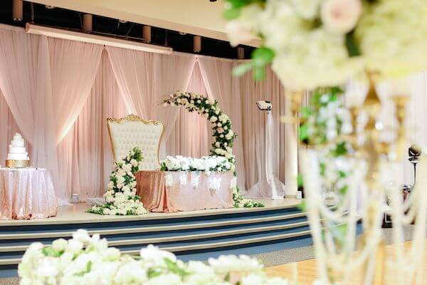 Luxurious Tarpon Springs wedding decor in gold, white and soft pink with a magnificent sweetheart table