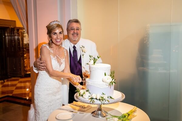 bride and groom cutting wedding cake at their intimate Tampa wedding at The Vault