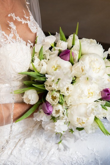 romantic bridal bouquet with frilly white tulips, peonies and sweetpeas