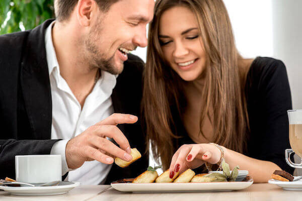 young couple tasting foods for their wedding reception