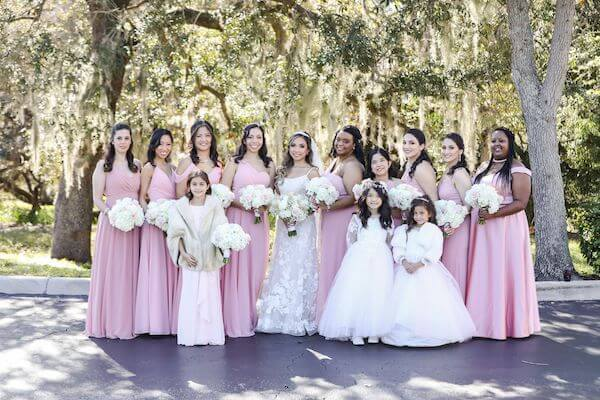 bride with her wedding party in soft pinks with romantic wedding bouquets