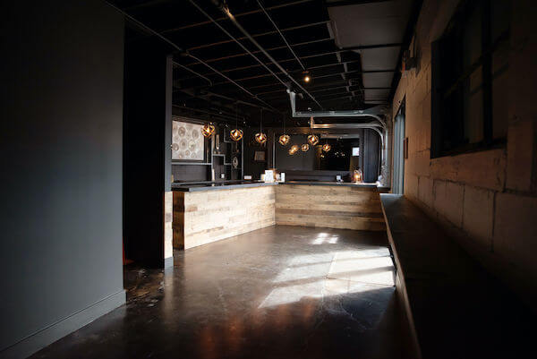 the rustic industrial indoor bar are of The West Events in Madeira Beach