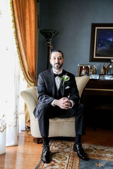 handsome Tarpon Springs groom in Black tie wedding attire