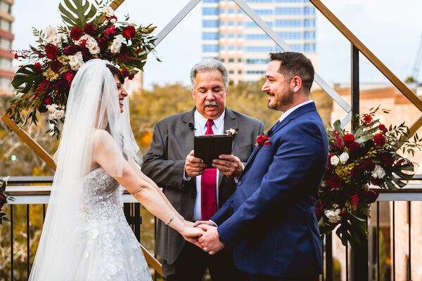 bride and groom exchanging wedding vows during their downtown St Pete rooftop wedding ceremony