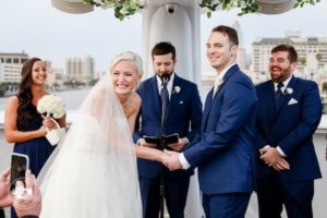 Laughing bride and groom during their Tampa wedding on the Yacht StarShip