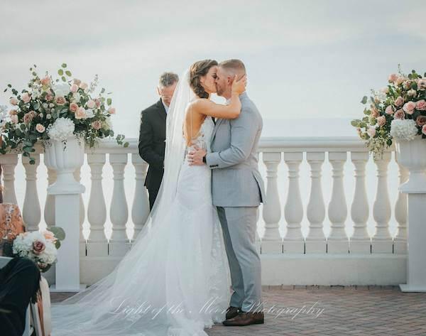 just married! Bride and groom kiss after their Hyatt Clearwater Beach wedding